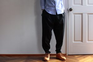 RAINMAKER Pleated Zip Hem Trousers